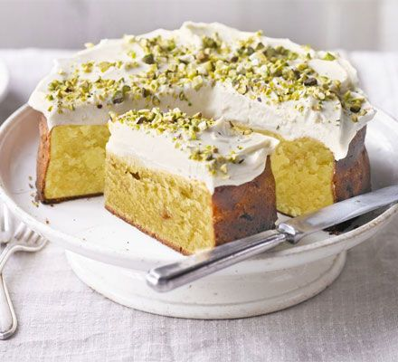 A dense and indulgent tea shop-style sponge cake with white chocolate and cream cheese frosting
