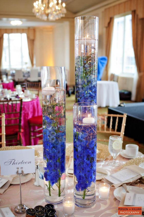 Modern centerpiece of submerged flowers purple