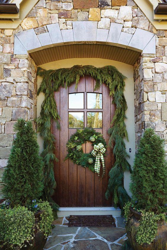 Cedar garland above beautiful door decorated for Christmas