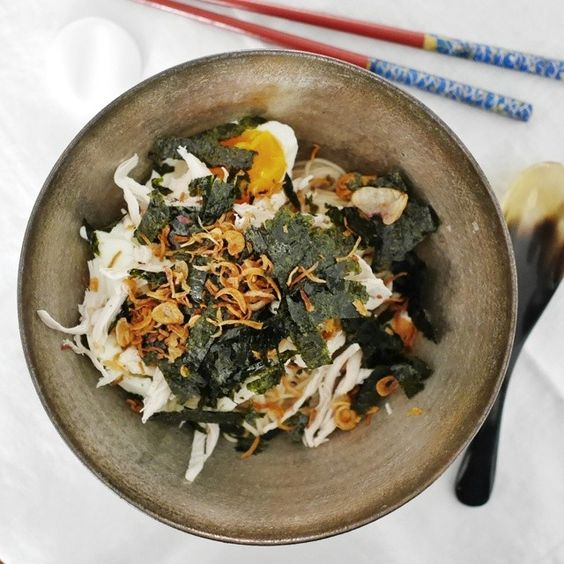 Cold somen tossed in a reduced chicken stock sauce, with shredded chicken, nori (seaweed) and fried onions. Lovely light lunch that makes us...