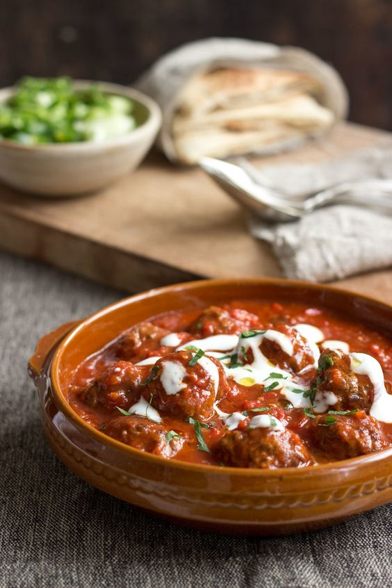 Saucy Greek Meatballs.  You can serve this up inside hot Pitta bread or as a main with the bread, greek salad and Tzatziki on the side.