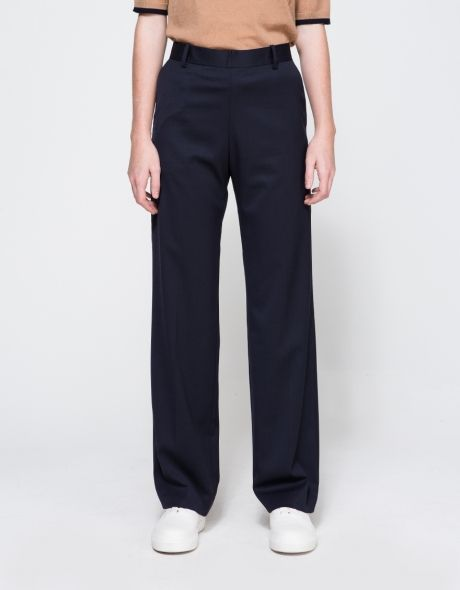 From Wood Wood, an elegant mid rise, lightweight soft wool blend pant in Navy.  Features concealed zipper back, interior button, back right welt pocket, belt loops, slanted front pockets, straight leg, full length leg and classic fit.  •	Mid rise, light