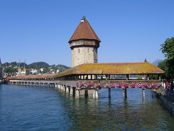 The Chapel Bridge is a 204 meter (670 foot) long bridge crossing the Reuss River in the city of Lucerne in Switzerland. It is the oldest wooden covered bridge in Europe, and one of Switzerland's main tourist attractions.