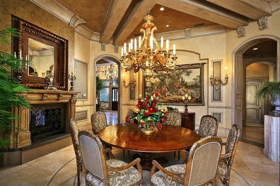 Traditional Dining Room with Cement fireplace, limestone tile floors, Exposed…