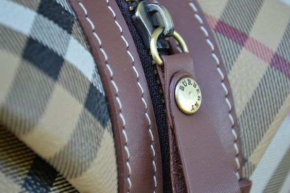 Burberry Bag (Fake)     clutches and checks and brightly coloured leather.  http://astore.amazon.com/buy_burberry-20