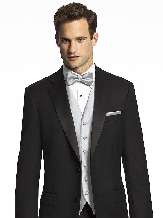 Men's silver or gray bowtie and vest with a black suit, groom