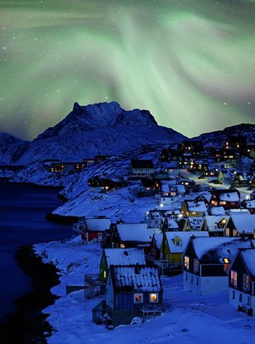 Nuuk, Greenland  Humpback whales! Fjords! Icebergs! The northern lights! Those are just a few of the things you'll find in Greenland's tiny capital city. The waterfront, made up of brightly painted houses, is the perfect contrast to the freezing arctic weather.