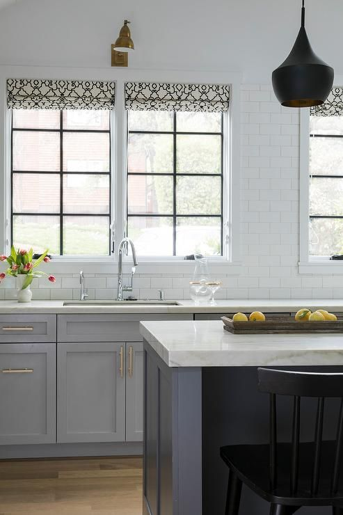 Light Gray Shaker Cabinets Featuring Brass Pulls And White Gray
