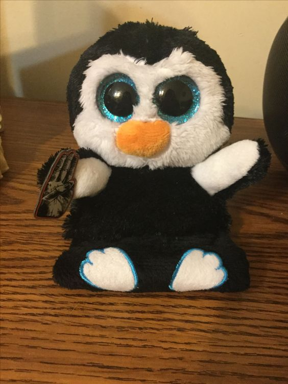 I put my Hunger Games pin on my penguin