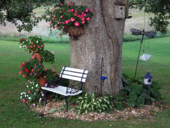 backyard landscaping around large trees   Flowers around a big oak tree.