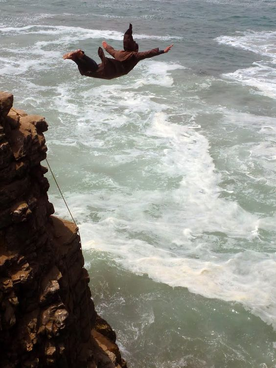 person jumping into the sea in Lima