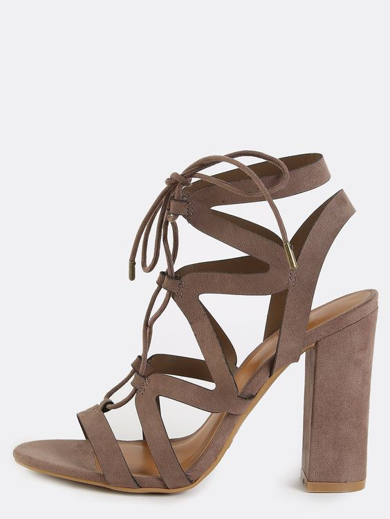 Keep cool in the Open Toe Strappy Chunky Heels! Features an open toe, laced up…
