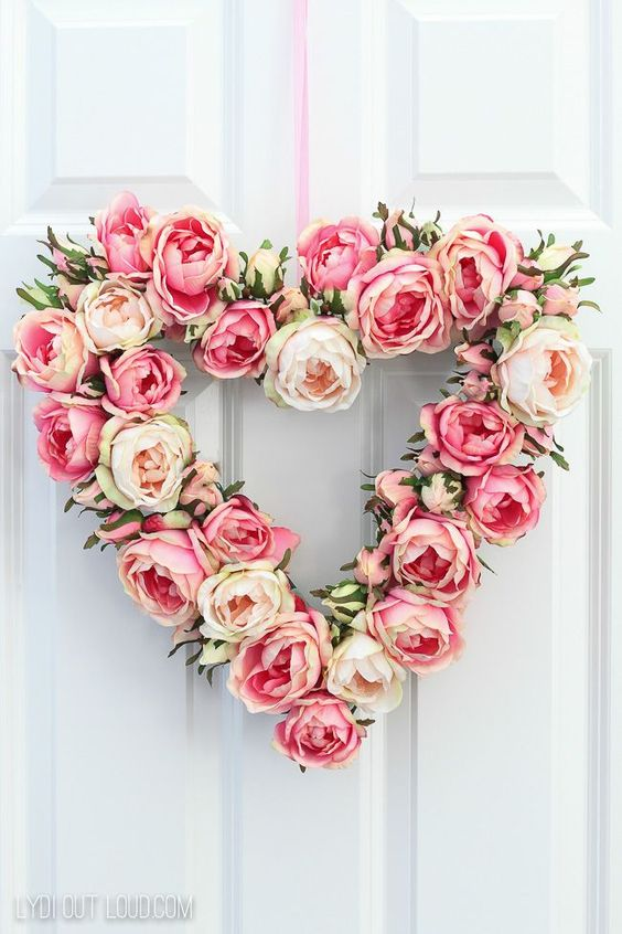 DIY easy and simple floral Valentine's Day wreath ideas for your front door or inspiration for any room in your house. You can even purchase the flowers from the Dollar Tree and make this an easy craft project for the kids. #valentinesdaywreath #diywreath #valentinesday #valentinesdaywreathideas #farmhousewreath
