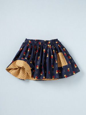 Reversible skirt. This is adorable, and I think it would be fairly easy to sew.