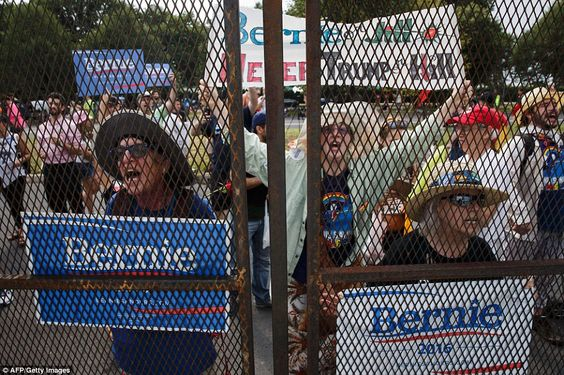 """""""We are not a country that cowers behind fences"""" says Hillary...yet this is what the DNC convention does with Bernie Sanders supporters...clearly this must be Trump and Putin's fault...LOL."""
