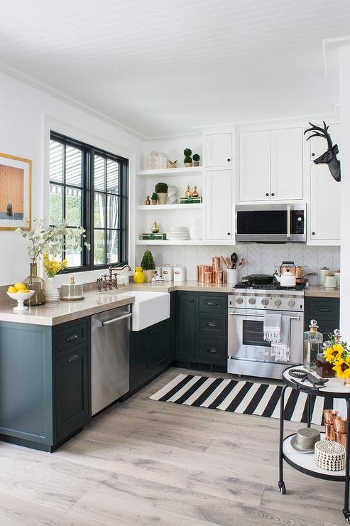 Small Eclectic Black And White Kitchen Features A Black And White Striped Runner Placed In Front Of A Stain Small Kitchen Layouts Simple Kitchen Kitchen Layout