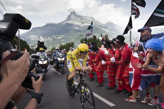 Megeve, France  Fans cheers as Britain's Chris Froome, wearing the overall leader's yellow jersey, passes during the eighteenth stage of the Tour de France. Froome dominated the eighteenth stage time trial to take his second stage win and extend his overall lead to 3min 52sec over Bauke Mollema, with Adam Yates a further 24sec back