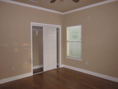 i like the dark floors with the tan walls white trim