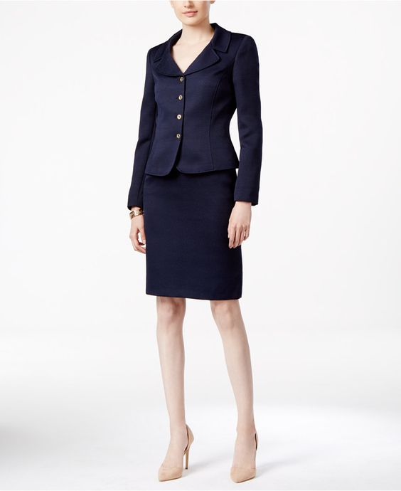 Whether at work or on a special occasion, this chic skirt suit from Tahari Asl…