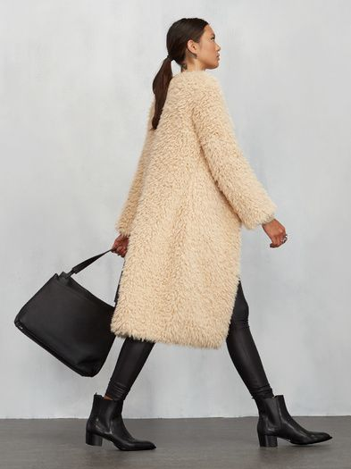 Take on the colder weather and look good doing it. The Brixton Coat is one of those you can throw over any ole outfit and you've got something special. It does the work for you, really. This is a knee length coat with front hook closures. Loose fit, fully lined. Made from surplus fabric.