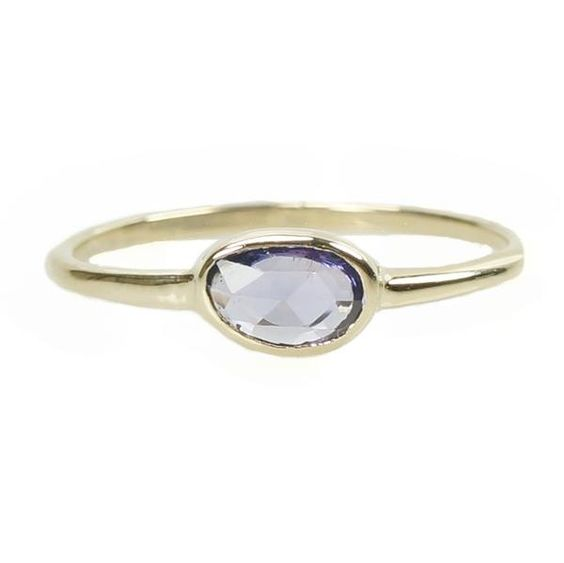 Crafted of Recycled 14k Yellow gold and set with a Rose Cut Violet hued Sapphire, this ring is simply beautiful. The Sapphire is set in a smooth Bezel, with a h