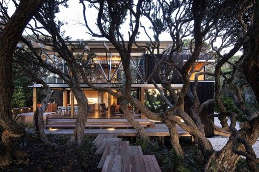 """Gorgeous design by Herbst Architects in New Zealand. With photographs by Patrick Reynolds. """"The site with which we were presented was extremely challenging in that it was 90% covered in mature pohutukawa trees, the site being a part of a continuous belt of forest that edges the road along the beach front."""""""