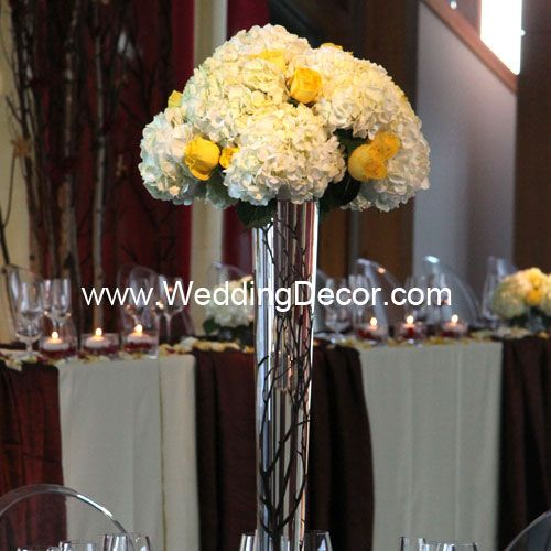 Wedding centerpiece hydrangea and yellow roses on top of