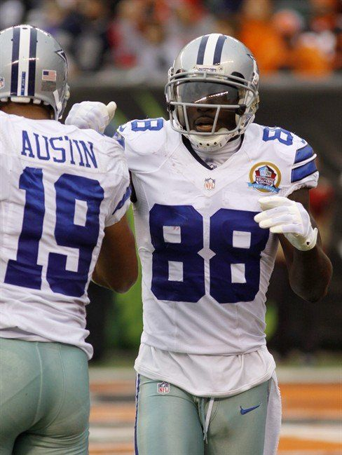 Dallas Cowboys wide receiver Dez Bryant (88) is congratulated by wide receiver Miles Austin (19) a