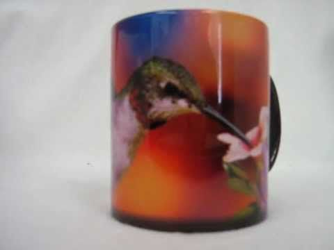"""Color changing coffee mug with a picture of a beautiful ruby throat hummingbird on it. The mug starts out as a dark color, add a warm beverage into it and the image of the hummingbird appears on the mug! Available at Amazon.com, see this and others for sale by going to amazon.com put """"teranew"""" in the search box and click on the """"go"""" button to vi..."""