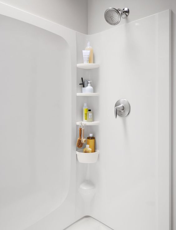 """Your suction-cup """"stainless-steel"""" shower caddy never stays put and looks a little rusty. Install a sturdier place to file away each family member's boutique conditioner—as many as 30 bottles—with prefab walls made of fiberglass and resin that click together. Shown: Sterling Plumbing's Store+ shower system, from about $680"""