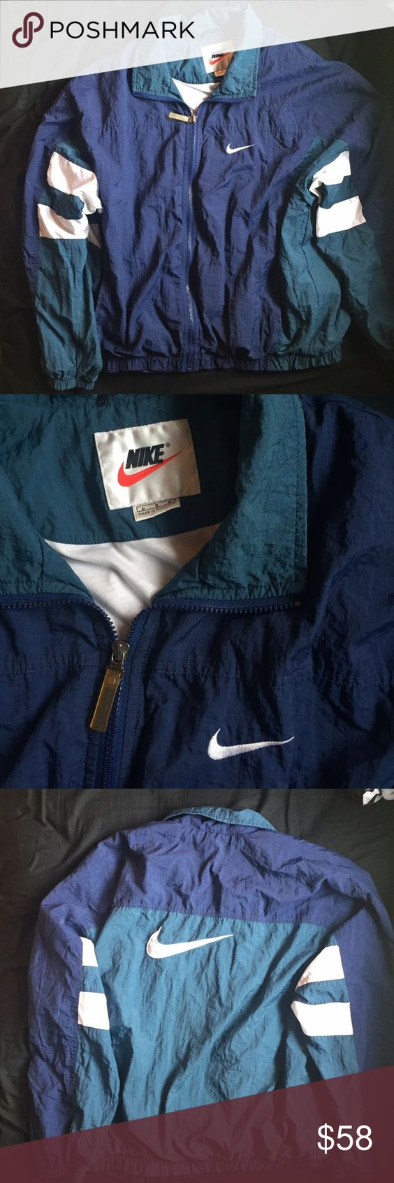 """Vintage Men's Nike Windbreaker Great condition. One very small, faded white spot - I have not tried to scrub this as I don't want to risk the jacket. Dark navy blue and dark teal with white sleeve stripes, front Nike """"pocket"""" logo, and large back Nike swoosh.  I'm selling this for someone else - therefore I cannot be as flexible with prices as normal. If you need more info, don't hesitate to ask!💕 ❌No trades.  ❌No holds. Nike Jackets & Coats Windbreakers"""