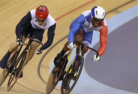 Britain's Jason Kenny (red helmet) competes with France's Gregory Bauge during the track cycling men's sprint gold finals at the Velodrome during the London 2012 Olympic Games.