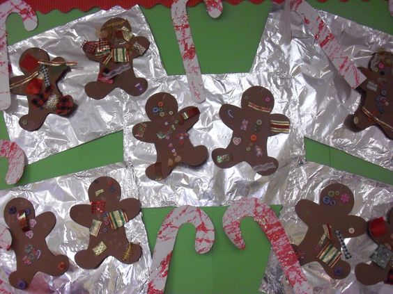 """The children enjoyed adding strips of ribbon, fabric and buttons to the gingerbread shapes. The candy canes were marbled painted and sprinkled with shiny shred. We stapled the gingerbread people to sheets of foil for a fun """"freshly baked with love"""" holiday bulletin board idea."""