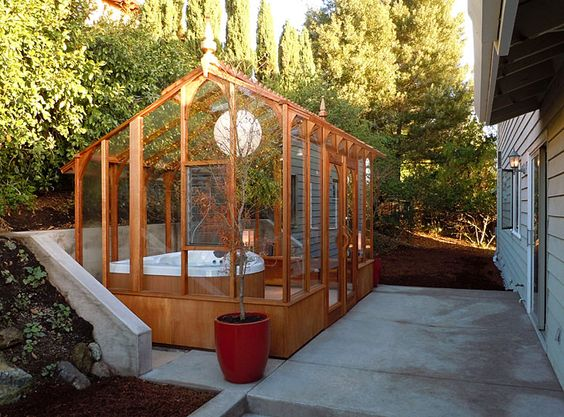 As far as hot tub enclosures go, this one is simple enough but still nice. It surrounds the area with something like a greenhouse, protecting it from inclement weather and debris.
