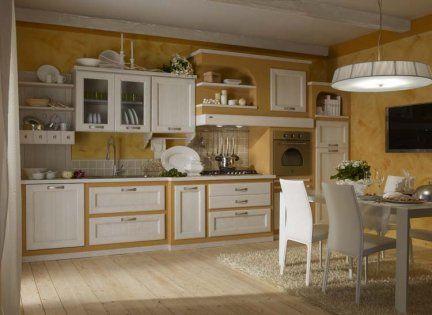 Cucina Carlini modello Carolina castagno massello con fronte effetto muratura su basi e colonne. Piani e schienali piastrellati monocottura.  Offerta expo per rinnovo spazi espositivi.