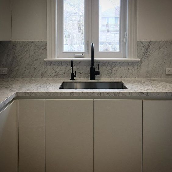 Kitchen Sink Installation | Montana Labelle Design. #interior #interiors #interiordesign #interiordesigns #interiordesigner #interiordecor #design #designs #designer #decor #decorating #decoration #toronto #torontodesign #yyz #torontointerior #montanalabelledesign #kitchen #kitchendesign #blackfaucets #house #home #luxe #luxury #marble #counters #countertops #waterstone #faucet