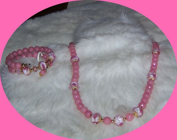 Pink Ruby faceted with lamp work rose beads.