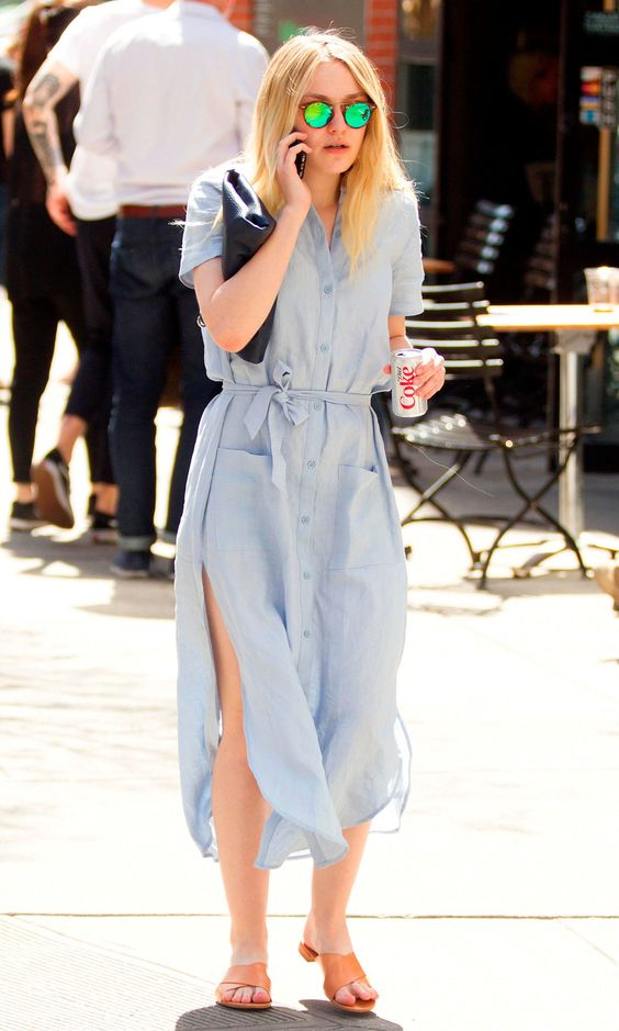 18 April Dakota Fanning also opted for a shirt dress. She paired her blue flowing frock with Mansur Gavriel sandals and green mirrored sunglasses.   - HarpersBAZAAR.co.uk