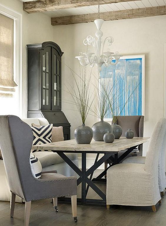 Transitional Dining Room. Transitional Dining Room with X Based Dining Table,  natural linen slipper chairs and gray wingback captain dining chairs.  Interior Design by Beth Webb Interiors.