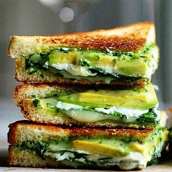 Goddess Grilled Cheese by @thedelicious!  1.Toast 2 slices of bread . 2.In a pan on medium heat sautée 1/2 cup spinach in a tablespoon of EVOO, and a pinch of salt and pepper. Layer spinach onto toast . 3.Layer 2 fresh slices of mozzarella cheese on top of the spinach layer . 4.Use half of a softened avocado to slice and layer on top of the cheese. . 5.Layer with additional spinach and cheese if you'd like, then grill on a pan mediu
