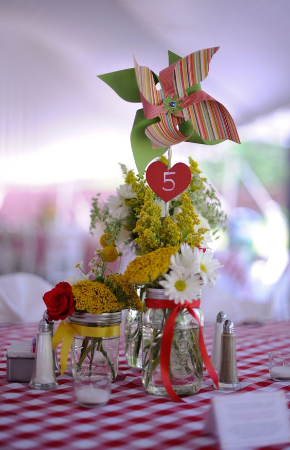 Cute pinwheel centerpieces for a May 2012 wedding. Bride and Mother of the Bride made all of them! Picture provided by Sara Ackerman Photography.