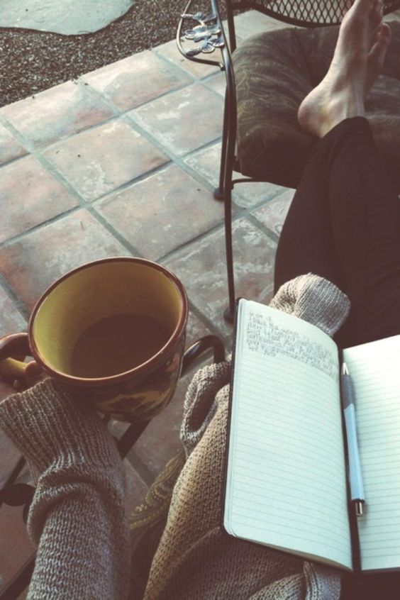 A few of my favorite things crammed into one picture: Coffee, writing, sweaters, and being barefoot.: