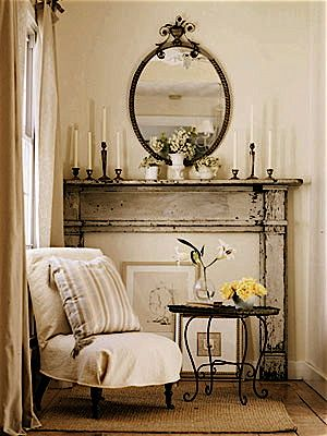 Beige living room chippy mantle oval antique metal mirror linen chair ♥ this little space!