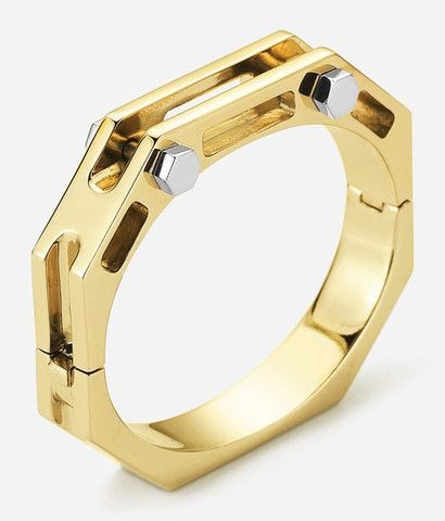 """A BOLD HINGED CUFF WITH CONTRASTING RIVET DETAILS. Suggested to be worn stacked or alone. .5"""" Wide, Fits wrists up to 7"""" in diameter."""