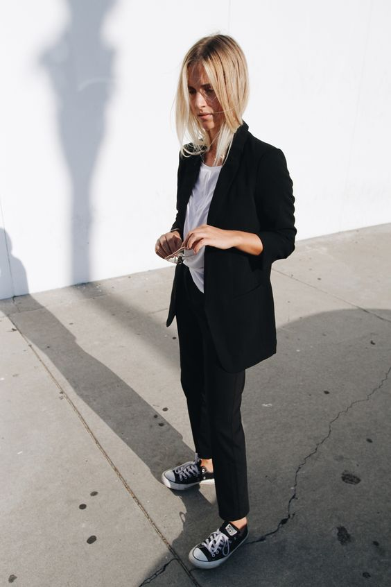 Black suit, chucks & vintage glasses. Via Mija:
