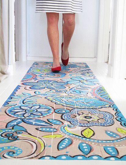 Painted faux rug on wood floor
