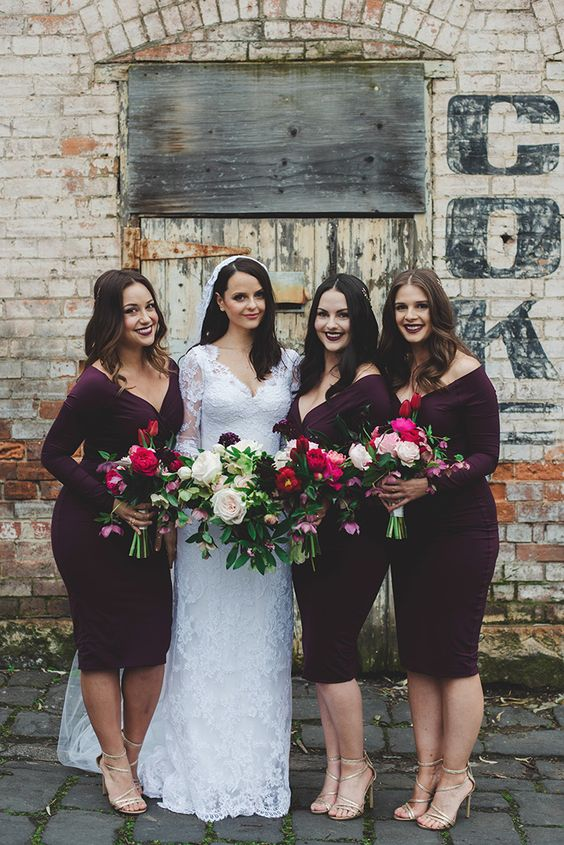 Romantic plum cocktail bridesmaid dresses for winter wedding | Tess Follett Photography | See more: http://theweddingplaybook.com/12-bridesmaid-dress-ideas-you-and-your-girls-will-love/