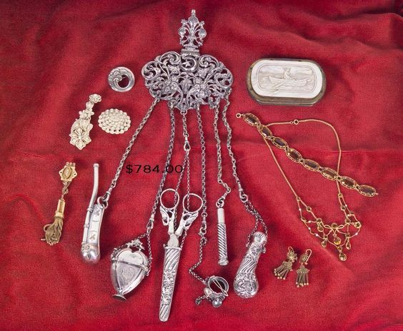 """Beautiful chatelaine. Chatelaine is a device which clips to the waist band or belt of a dress for holding such items as the mistress of the house would need with her throughout the day. It might include her seal, watch, scissors, thimble, a vinaigrette, and a key holder."""""""