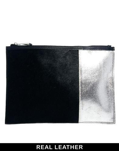 Image from http://cdn1.picvpicimg.com/pics/2038510/black-and-silver-asos-asos-leather-clutch-bag-in-pony-with-leather-panel.jpg.