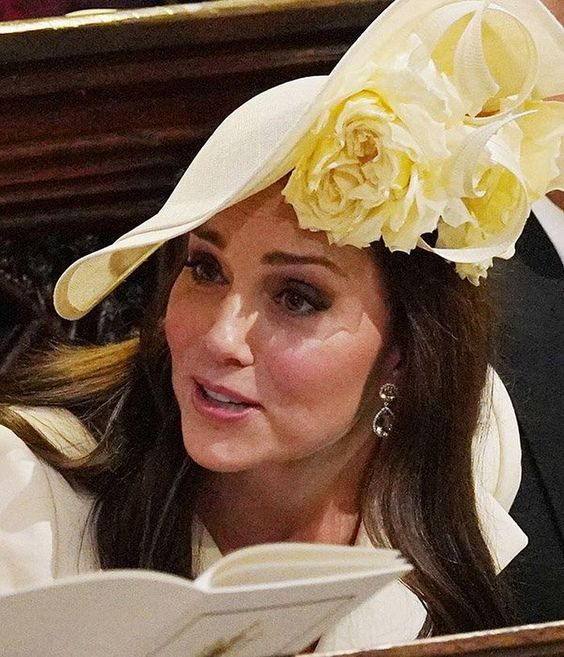 Kate accessorized with a new floral Philip Treacy hat from the SS18 Collection for Meghan's wedding.